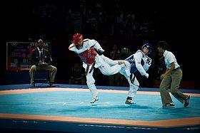 Combat de taekwondo WTF aux Jeux olympiques d'été de 2012 à Londres ========================= Bonjour, pour les bijoux Gaby Féerie => http://www.alittlemarket.com/boutique/gaby_feerie-132444.html