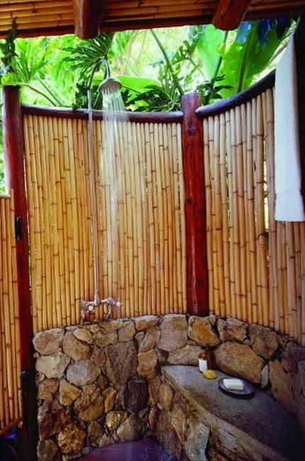 outdoor showers built with stone, concrete and tiles