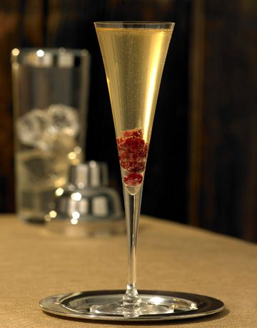 Ruby Sipper. What about 1 drop of grenadine, champagne and a frozen raspberry?