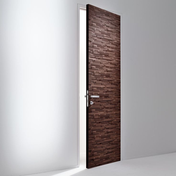 Decor Slim Door. The door jamb is flush with the wall and becomes one with the same when the same finish is applied. - By Bartoli Design | Laurameroni