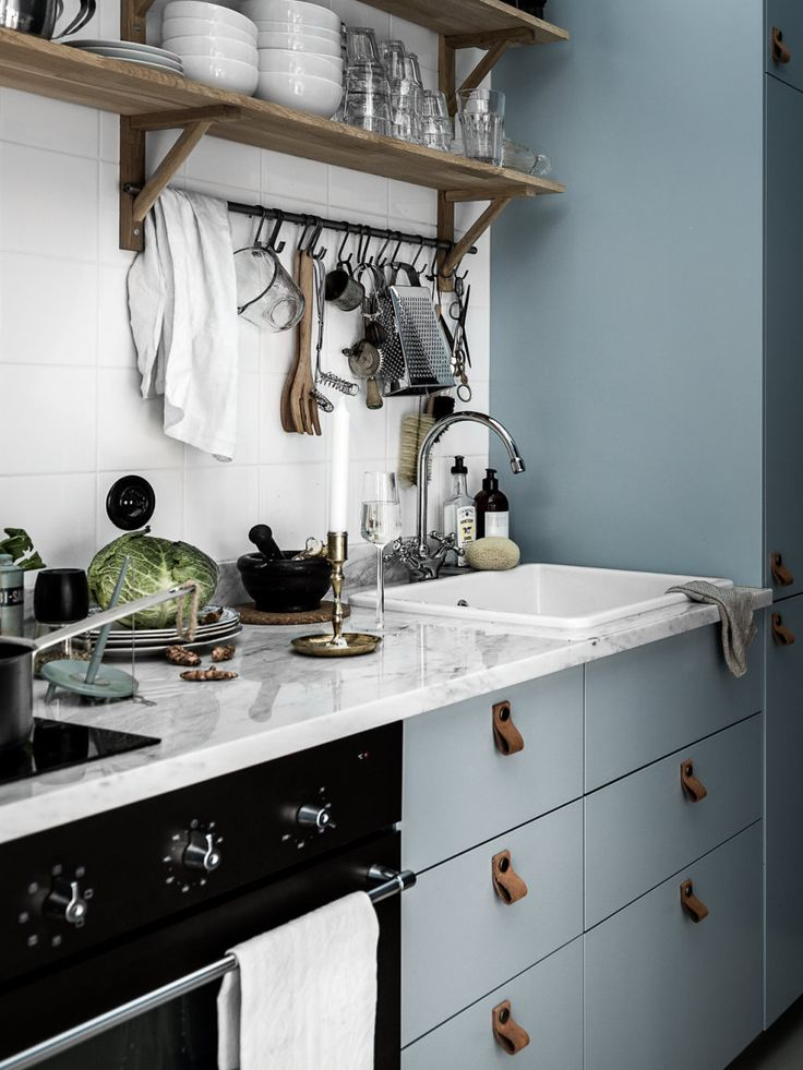 Leather pulls as drawer handles in kitchen