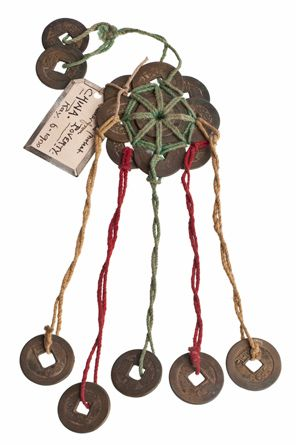 Amulet to protect weaver from poverty, comprising several coins bound together into a circle with five coins suspended beneath and two above.