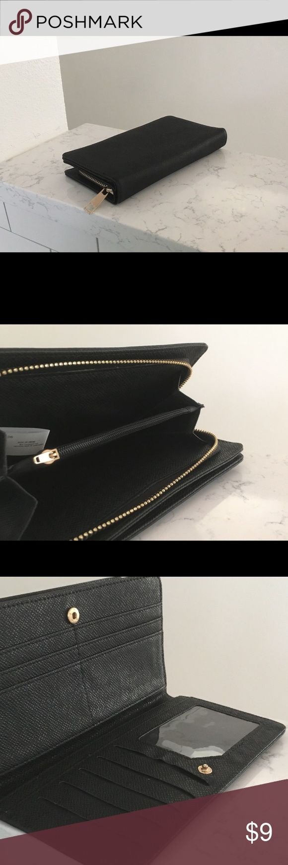 Women's black wallet Inventory refresh! This is a new wallet from my online boutique, wilcolife.co. Clearing out some inventory to make room for new product. No particular brand, just a great everyday staple. Faux leather. Bags Wallets