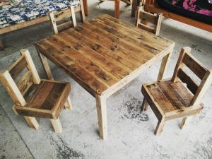 Childrens play setting, pallets and murray pine flooring.