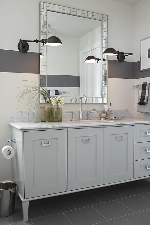 Sarah Richardson. This bath was designed for a teenage boy. I love the grey & white colors, the distinctive grey stripe in the walls & the black accents...V
