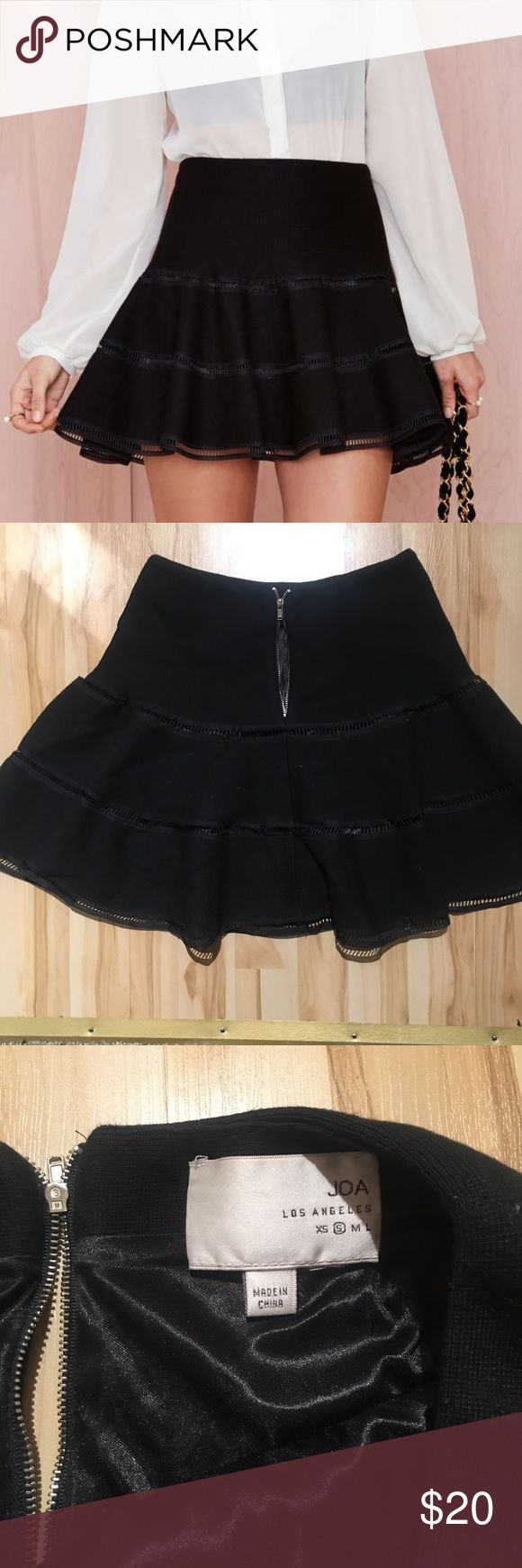 JOA flared skirt Joa flared skirt from Nasty Gal. Black, fully lined, size small. PLEASE NOTE: zipper is broken, very easy fix! This season, we strongly suggest skirting the issue. The Flare Up Skirt is black and has cutout detailing, stretch fabric, and full lining. Silver zip closure at back. We love it with a structured crop top, leather moto jacket, and platforms for the perfect day-to-night look. By Joa. Nasty Gal Skirts A-Line or Full