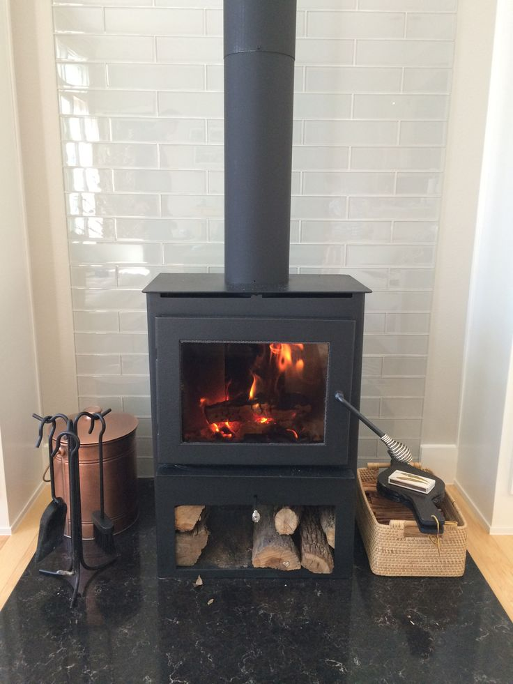 Woodburning stove with glass 3x12 tile behind