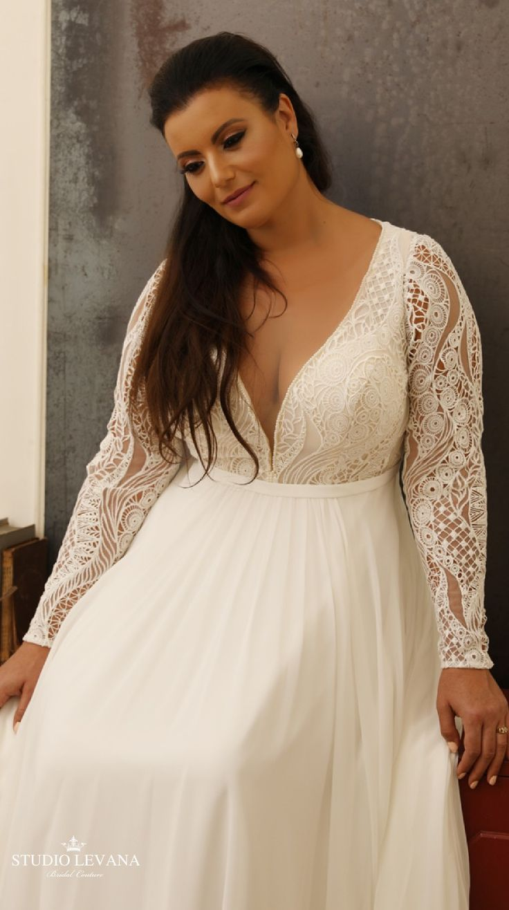 Bohemian dress with long sleeves and a deep V-neck. Margin ...