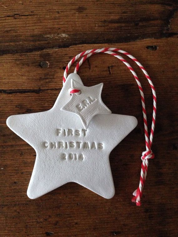 A white clay hanging decoration, hand printed with First Christmas 2014. It would make a great Christmas gift for a partner or newlywed couple or for a