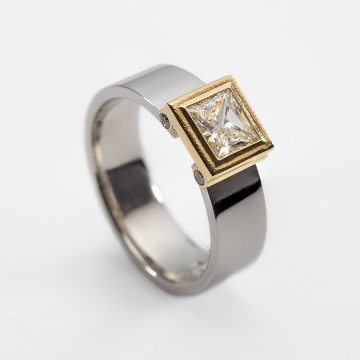 Contemporary platinum engagement ring with 0.53ct princess cut diamond and 4 small accent diamonds. Engagement rings Cork city.