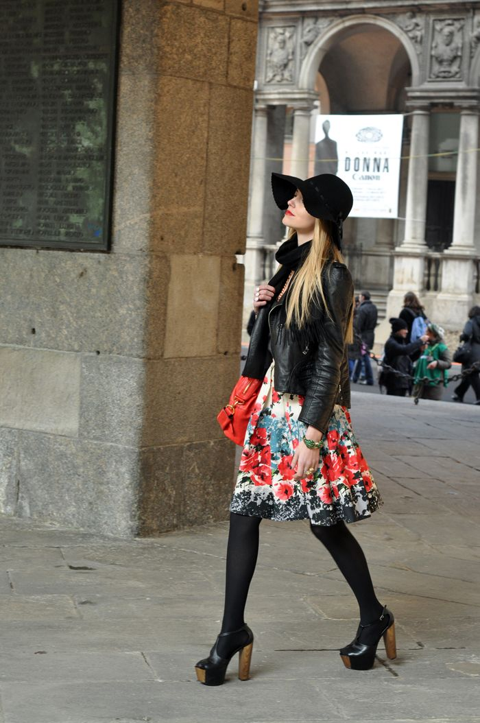 Chiara of The Blonde Salad is wearing a fabulous outfit during Milan Mercedes Benz Fashion Week.  Love the combination of the biker jacket and platforms.