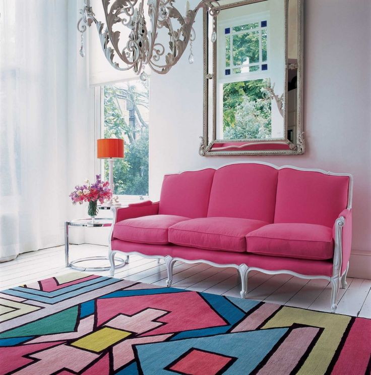 http://www.drissimm.com/wp-content/uploads/2015/03/pretty-combination-of-pink-in-the-interior-living-room-with-nice-wallpaper-including-mirror-on-the-wall-above-pink-sectional-sofa-also-lamps-table-in-the-near-and-glass-table-on-pink-rug-10.jpg