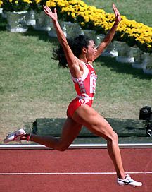 Florence Griffith-Joyner. 100 meters and 200 meters, both records set in 1988. Fastest woman of all time.