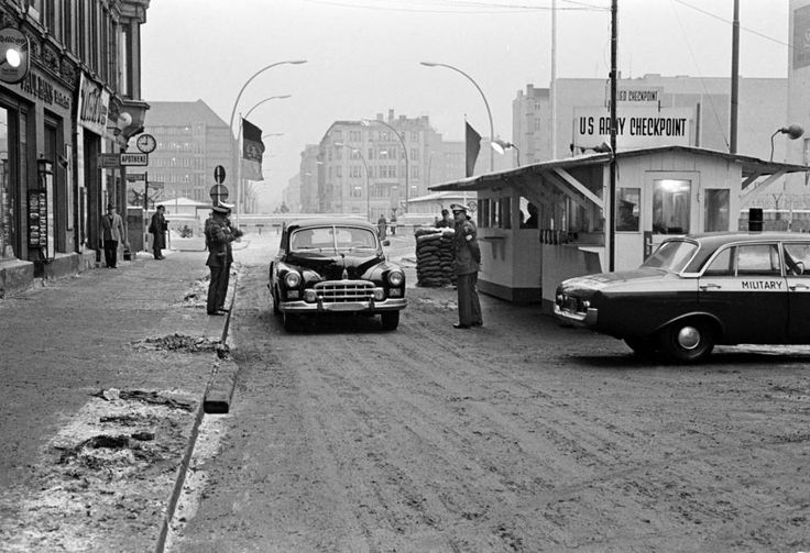 Despite the presence of steel barriers and a concrete wall instead of tanks at Checkpoint Charlie, all appears serene in this scene from Berlin Oct 64...