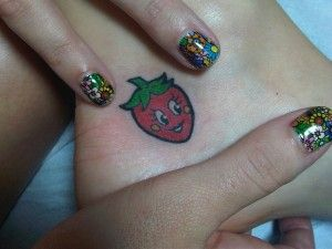 Katy Perry's strawberry tattoo on her ankle. -- ADORABLE.
