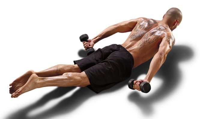 EXTENSION ARROW: Pilates for Men - Lie on your stomach with your legs extended, arms by your sides and palms facing up. Keeping your body long, lift your upper body and legs up with abs pulled in. Do 8-10 reps.