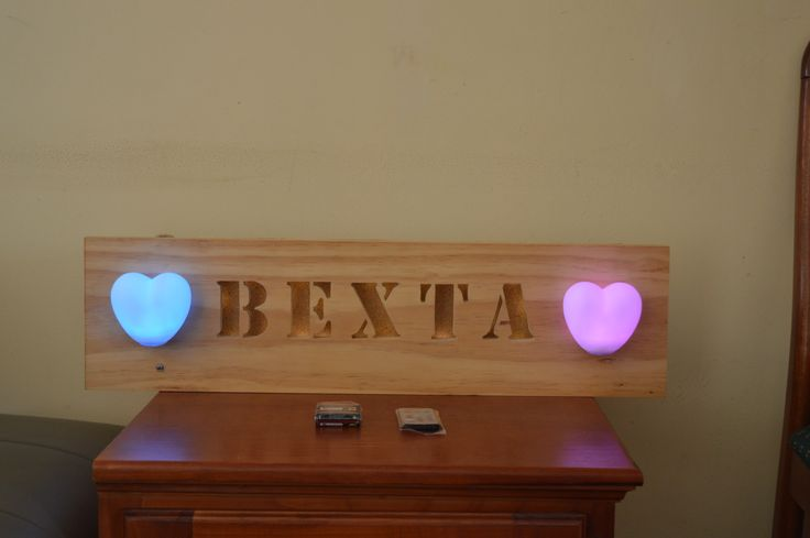 Customised Wood Sign Project with 2 Hearts LED. Made from Pine and runs on four AA size Batteries. The colour can be adjusted via Remote
