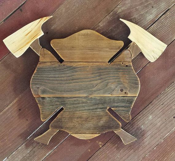 Delight the Emergency Service person in your life (or yourself) with a hand crafted wall hanging that reflects their pride in what they do every day.  The Firefighters Maltese Cross can be made with or without the crossed axes. It can also be customized to include the Fire Department name, the Firefighters name and/or a badge number.  Made from repurposed barn wood, this wall hanging would be a lovely addition to just about any room in the house. However, it has been treated so it will l...