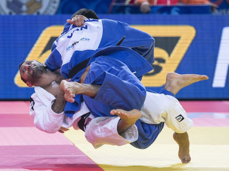 Azerbaijan's Nijat Shikhalizada (white) competes with Canada's Antoine Bouchard during the mens qualification match, in the -66kg category at the Judo World Championships in Astana, Kazakhstan.  Jack Guez, AFP/Getty Images