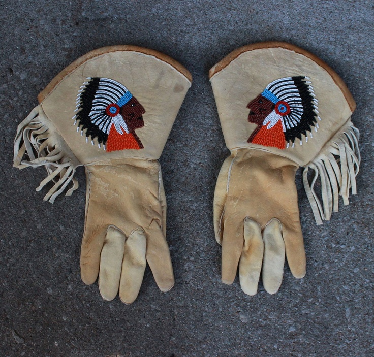 Hand Beaded Leather Native American Gauntlet Style Gloves with Fringe. ( 250.00, via Etsy.)