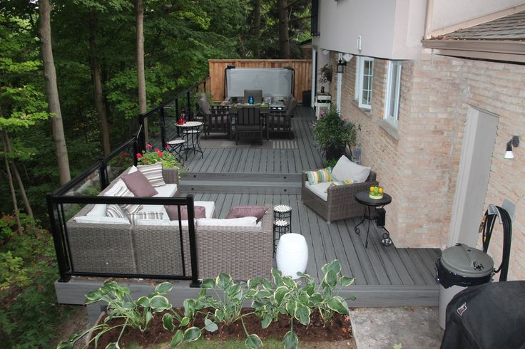 A multi-level low maintenance deck built by Hickory Dickory Decks using Armadillo grey decking. It is in Burlington Ontario.