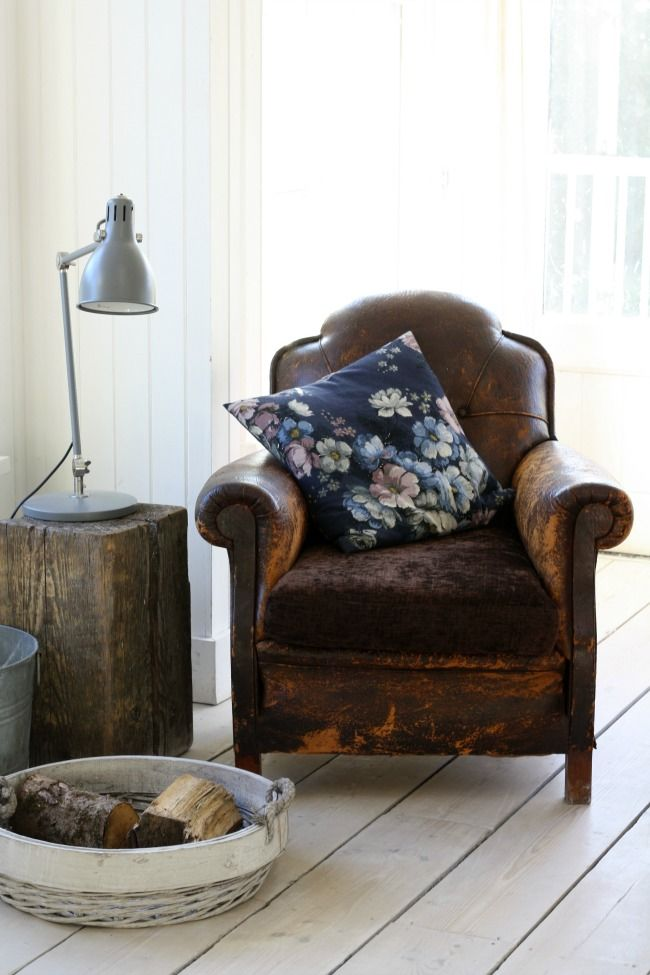 Aged leather chair, timber block side table, industrial desk lamp and  lots of light!