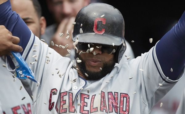 Cleveland Indians Carlos Santana is congratulated by teammates after hitting a two run home run in the seventh inning against the Detroit Tigers in the first game of a doubleheader in Detroit, Saturday, July 1, 2017. (AP Photo/Rick Osentoski)