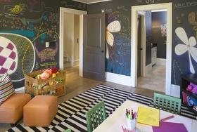 Neat playroom with chalkboard walls!