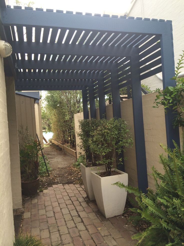 7.  AFTER PHOTO  A smart entrance was achieved to compliment the house. The closely placed slats of timber let in enough light , created privacy from the neighbours and protection for the garden on extreme weather days.  Patterson Lakes Melbourne