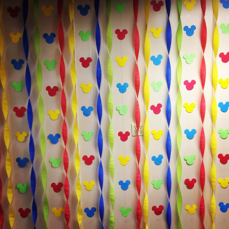 Photo wall backdrop or could just be decoration for Mickey Mouse Clubhouse birthday party. Simple streamers & cutouts.