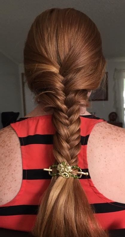 Herringbone braid in gorgeous red hair, styled with the gorgeous gold and green Olivia flexi clip.
