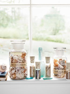 Display Your Shell Collection    Instead of hitting the souvenir shop, bring home a bit of the beach from your next vacation. Simply scoop up shells and sand, decant into pretty bottles—like these corked vials and apothecary jars—then add labels. Over time, you'll create truly personal mementos that double as a stunning vignette.