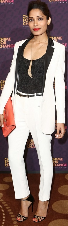 Who made  Frieda Pinto's white pants suit and orange clutch handbag that she wore in London on June 1, 2013?