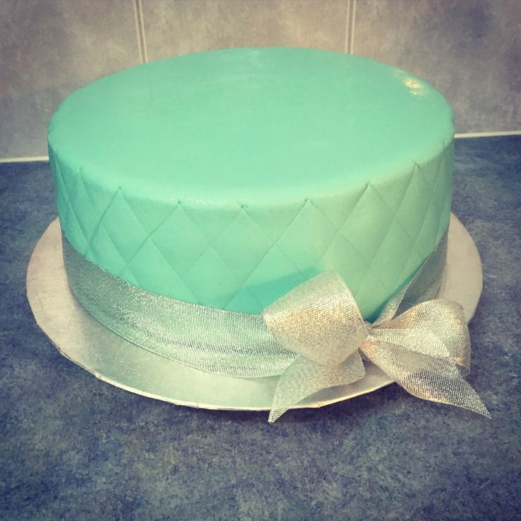 Vegan Marble Cake  Chocolate and vanilla cake covered in baby blue fondant and finished with ribbon