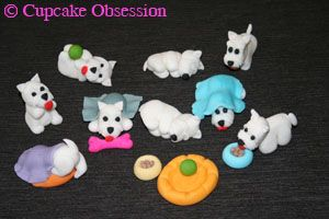 Just LOOK at the little Westie peeping out from under the turquoise blankie and the little Westie diving under the purple blanket with only his cute rumpus and tail sticking out! I'm in LOVE!! These appear to be cup-cake toppers, or you could use them all on top of a sheet cake: http://www.cupcakeobsession.com/home/westie-cupcakes-for-a-birthday/