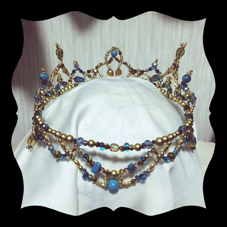A unique professional headpiece to be used for the role of Princess Florina or for any other classical variation. This tiara is entirely handmade by a famous Japanese tutu maker. The frame is gold and