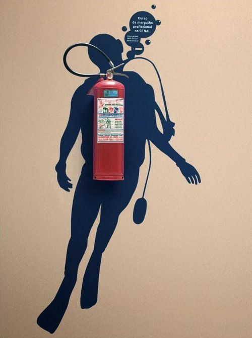 Don't hide the fire extinguisher, make it art!  Use a wall decal.