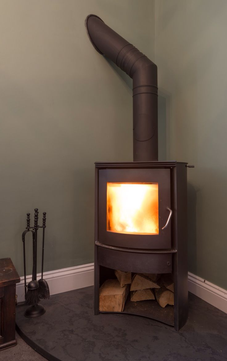 Corner log burner / wood heater.