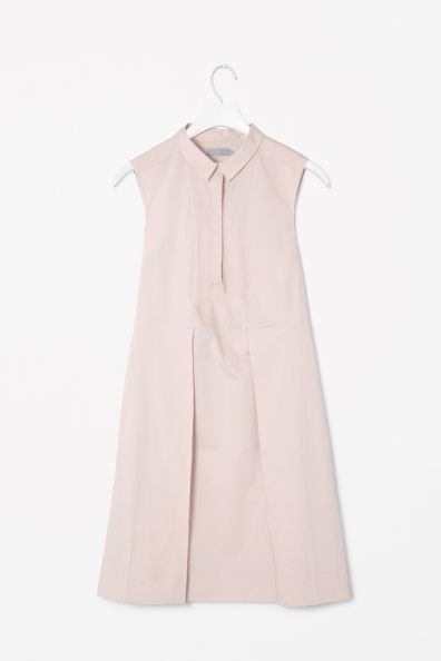 Cotton shirt dress by COS. Made from crisp cotton poplin, this sleeveless shirt dress has deep pleats at the front and back. A standard fit, it has side pockets and covered front button fastening for a neat finish.