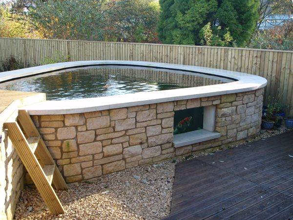 Building An Above Ground Pond | The advanced filtration system is housed under the raised decked area ...