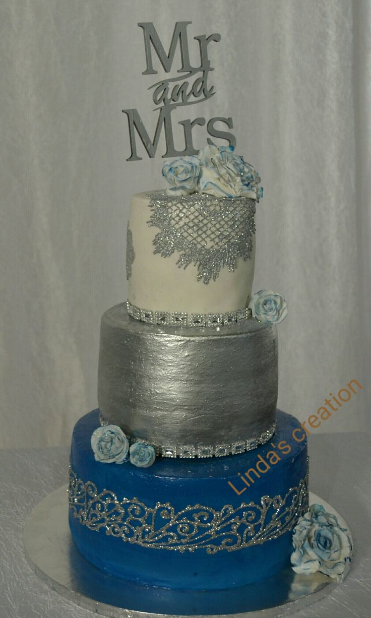 Royal blue, silver and white wedding cake.