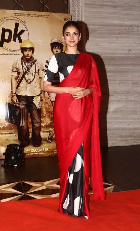 Aditi Rao Hydari in a polka dotted red saree by Masaba Gupta.