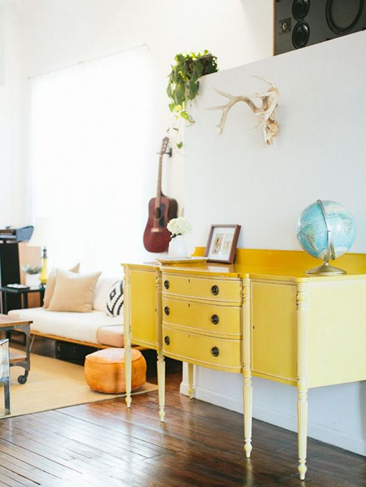 Yellow sideboard and dark wooden floors | photographed by the stoffers for rue magazine
