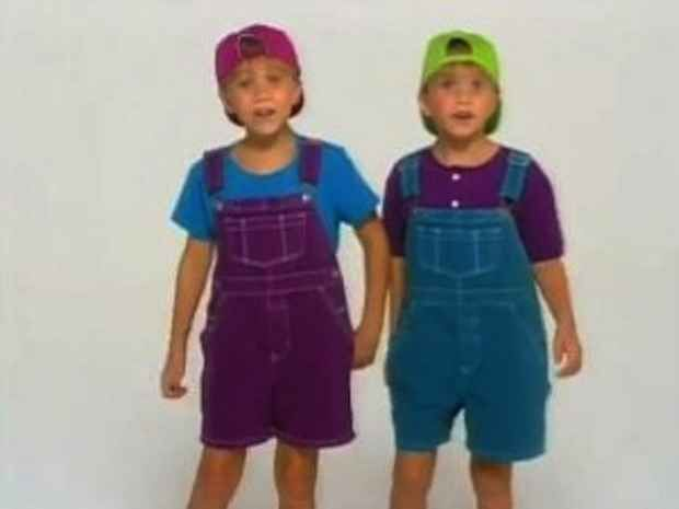 The Olsen twins wearing backward hats opposite colored overalls: | The 50 Most '90s Things That Have Ever Happened