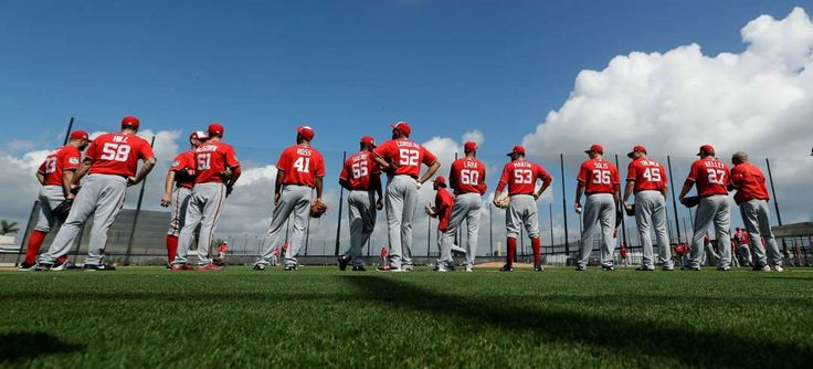 2017 spring training:     Get in line:    Washington Nationals pitchers stand along the third base line during a Feb. 19 workout in West Palm Beach, Fla.