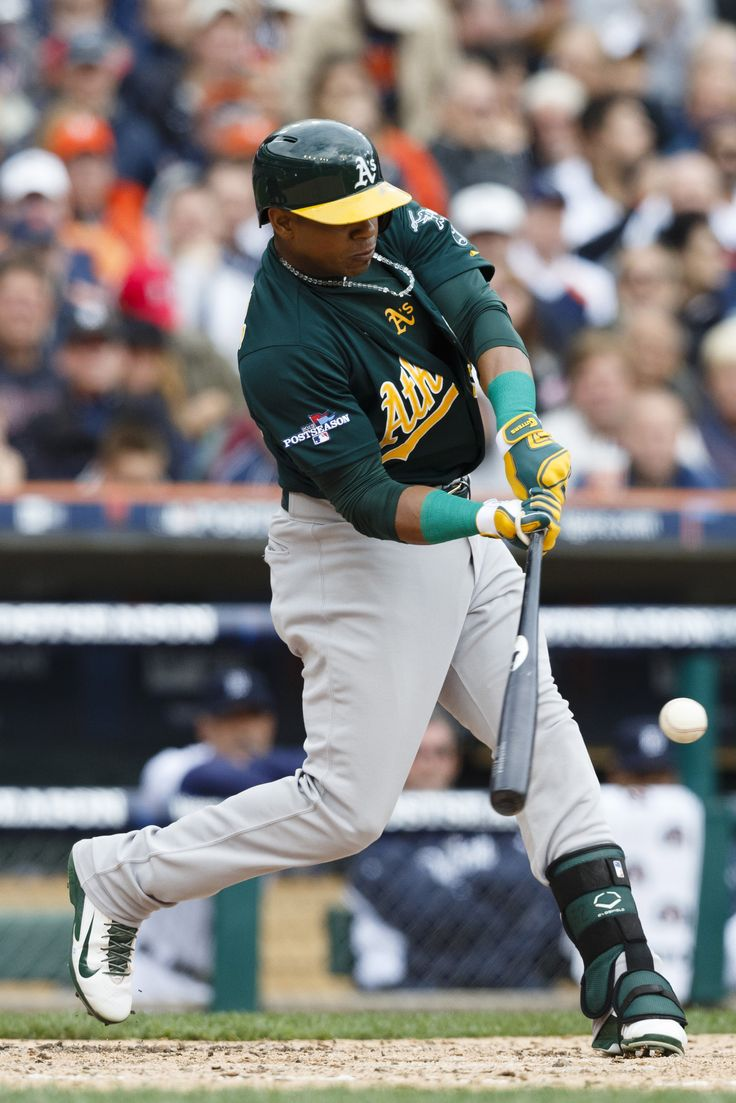 CrowdCam Hot Shot: Oakland Athletics left fielder Yoenis Cespedes reaches on a fielding error to score center fielder Coco Crisp in the third inning against the Detroit Tigers in game three of the American League divisional series playoff baseball game at Comerica Park. Photo by Rick Osentoski