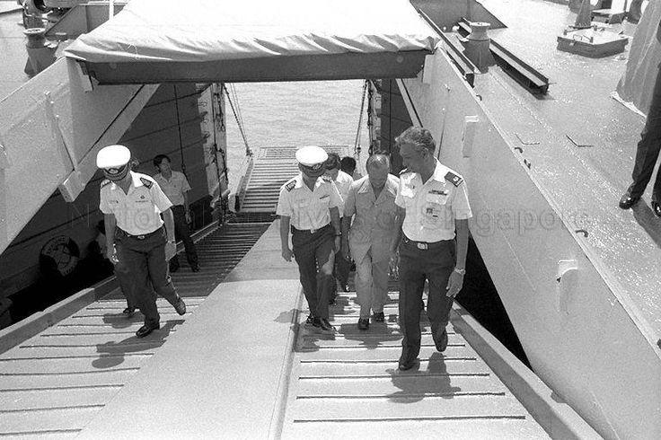 President Wee walking up the truck ramp of a Landing Ship Tank (LST) at Bani Naval Base- 1986