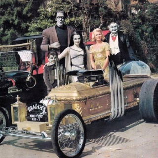 The Munsters ( Rare colour photo ) = obviously their TV show was filmed in B&W so to see a colour individual photo of the cast ,takes a while to get your head around !! ✔️