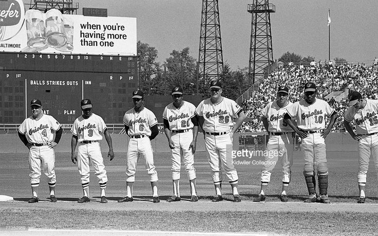 Members of the Baltimore Orioles line up along the thirdbase line prior to the…