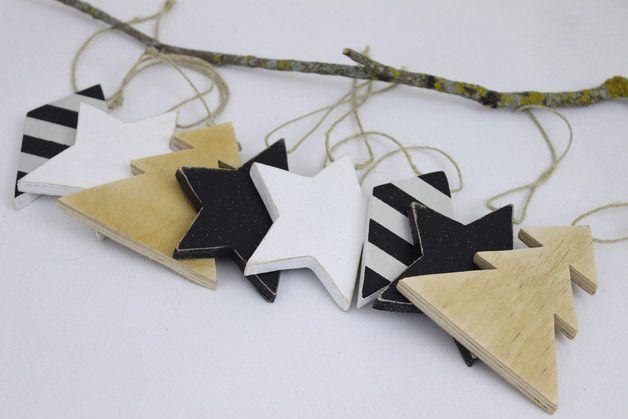 Hand cut and hand painted 9mm plywood Christmas tree ornaments, set of four. Stars and Christmas tree designs. Via en.DaWanda.com.